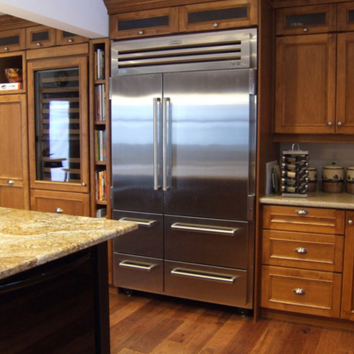 Wooden kitchen with big fridge