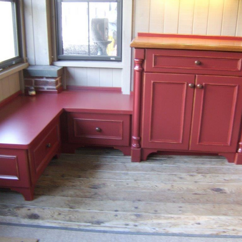 Red bench and storage for a mud room