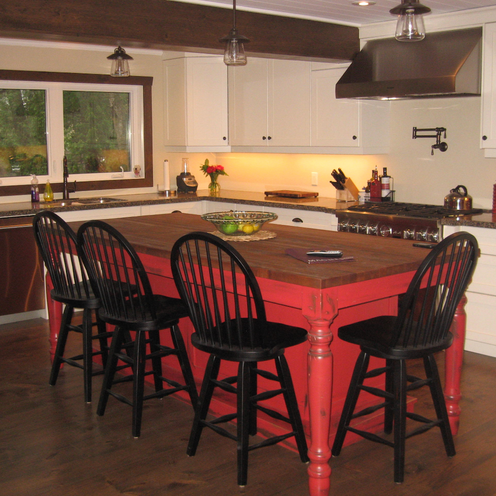 Red and dark wood kitchen island