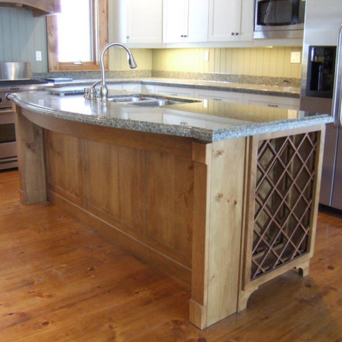 Wooden and marble kitchen island with wine rack